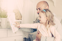 Girl giving her father a drawing, fathers day concept Stock Photos