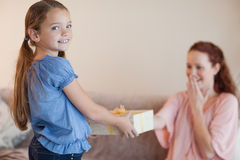Girl giving her mother a present Stock Photos