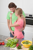 Girl giving his boyfriend a sandwich Royalty Free Stock Photos