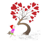 Girl giving kiss the tree Royalty Free Stock Photos