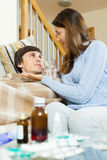 Girl giving  medicament to unwell husband Stock Photography