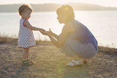 Girl Giving Mother Something Royalty Free Stock Image