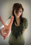 Girl giving peace sign Royalty Free Stock Images