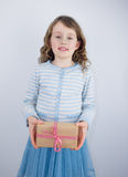 Girl giving present Royalty Free Stock Image