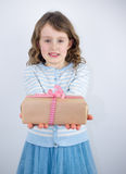 Girl giving present Royalty Free Stock Photos