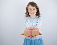 Girl giving present Stock Images