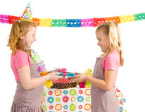 Girl giving present to other girl Royalty Free Stock Photography