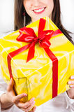 Girl giving present to you Stock Photography