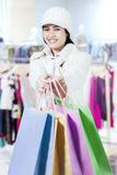 Girl giving shopping bags in the mall Stock Photo