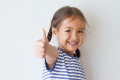 Girl giving thumb up hand sign Royalty Free Stock Images