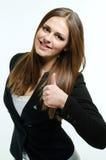 Girl giving thumb up. Happy and beautiful woman giving  thumb up Royalty Free Stock Image