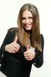 Girl giving thumbs up. Happy and beautiful woman giving thumbs up Stock Photography