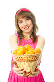 Girl giving us a basket full of tangerines Stock Image