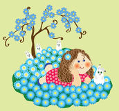 Girl on the a glade with flowers Stock Image