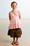 Girl in glamorous outfit smiling Royalty Free Stock Images