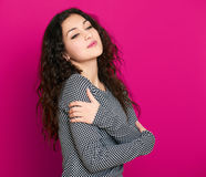 Girl glamour portrait on pink, long curly hair Stock Photography