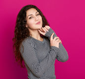 Girl glamour portrait on pink, long curly hair Stock Image