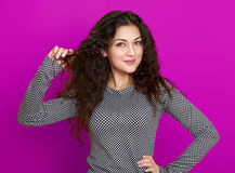 Girl glamour portrait on purple, long curly hair Stock Image