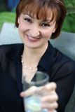 Girl with a glass. A woman offering a glass Royalty Free Stock Photography