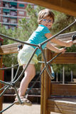 Girl in glass at action-oriented playground royalty free stock photos