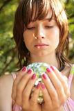 Girl with glass ball in hands. Girl with a glass ball in hands stock photo