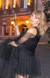 Girl with a glass of champagne in the city Royalty Free Stock Photo