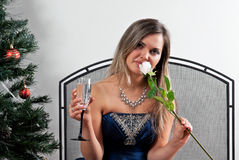 Girl with a glass of champagne and white rose Stock Photo
