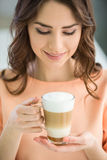 Girl with glass of coffee Royalty Free Stock Photo