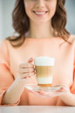 Girl with glass of coffee Royalty Free Stock Images
