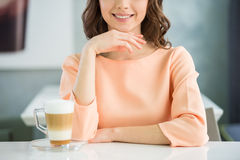 Girl with glass of coffee Stock Image