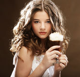 girl with glass of coffee witn cream Royalty Free Stock Image