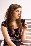 Girl with a glass of coke Royalty Free Stock Image