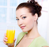 Girl with a glass of fresh orange juice royalty free stock images