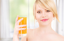Girl with a glass of juice Royalty Free Stock Images