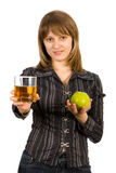 Girl with a glass of juice and an apple. Isolate Stock Photo