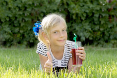 Girl with glass of juice Royalty Free Stock Image