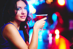 Girl with glass of martini Royalty Free Stock Photos