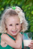 Girl with glass of milk Stock Photography