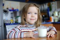 A girl with a glass of milk Royalty Free Stock Photography