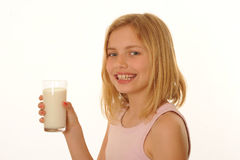 Girl with glass of milk Royalty Free Stock Photos
