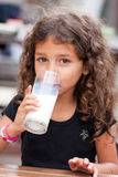 Girl and glass of milk Stock Photography