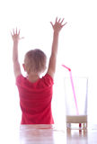 Girl and glass of milk. Empty glass of milk on the background of a joyful child Stock Images