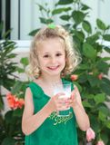 Girl with glass of milk Royalty Free Stock Photo