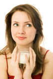 Girl with a glass of milk Stock Images