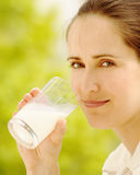 Girl with glass of milk. Girl holding glass of milk Royalty Free Stock Images