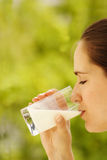 Girl with glass of milk. Girl drinking milk Royalty Free Stock Images