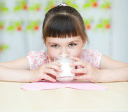 Girl with a glass of milk Royalty Free Stock Image