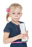 Girl with a glass of milk smeared lips regiment Stock Images