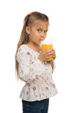 Girl with a Glass of Orange Juice Royalty Free Stock Photo
