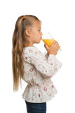 Girl with a Glass of Orange Juice Royalty Free Stock Photography